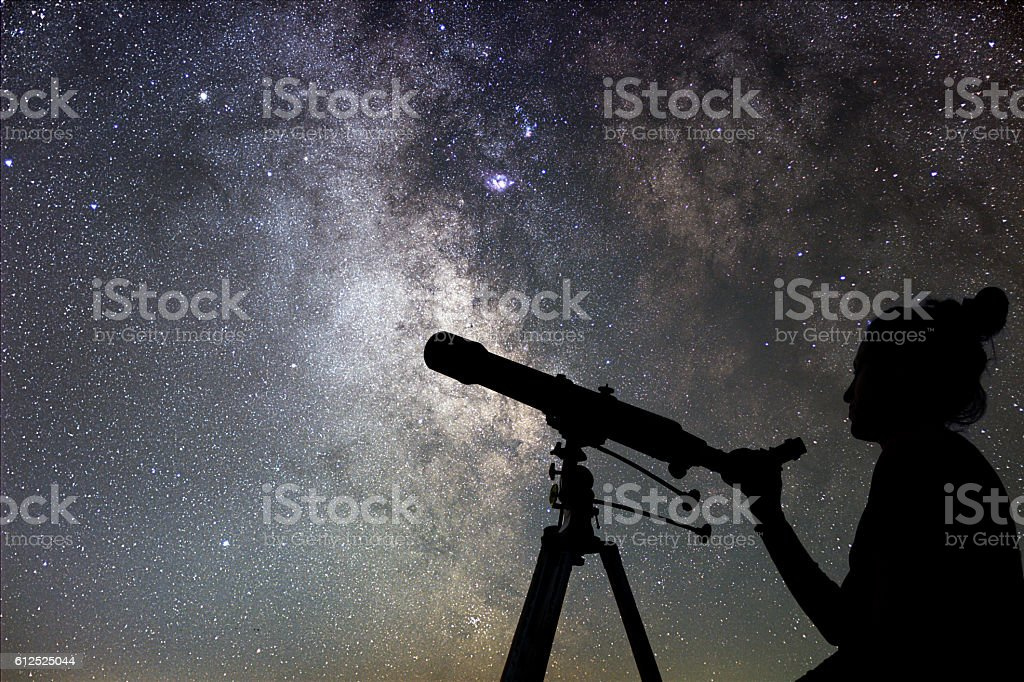 Woman and night sky. Watching the stars Woman with telescope. stock photo