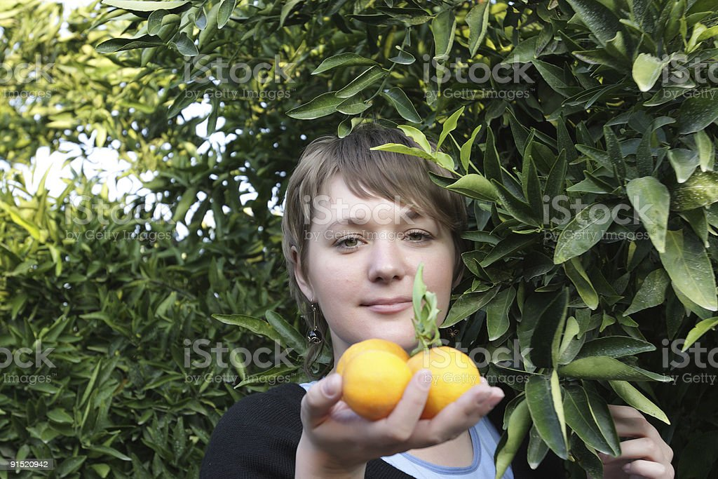 Woman and orange royalty-free stock photo