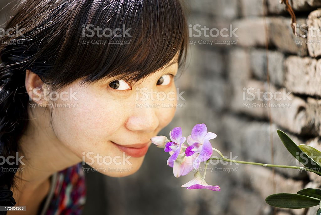 Woman and Orchid Flower royalty-free stock photo