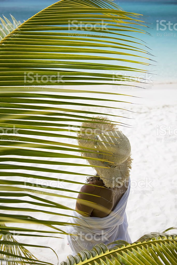 woman and palm fronds royalty-free stock photo