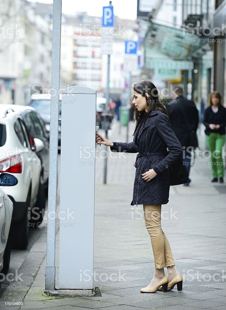 Woman and parking meter stock photo