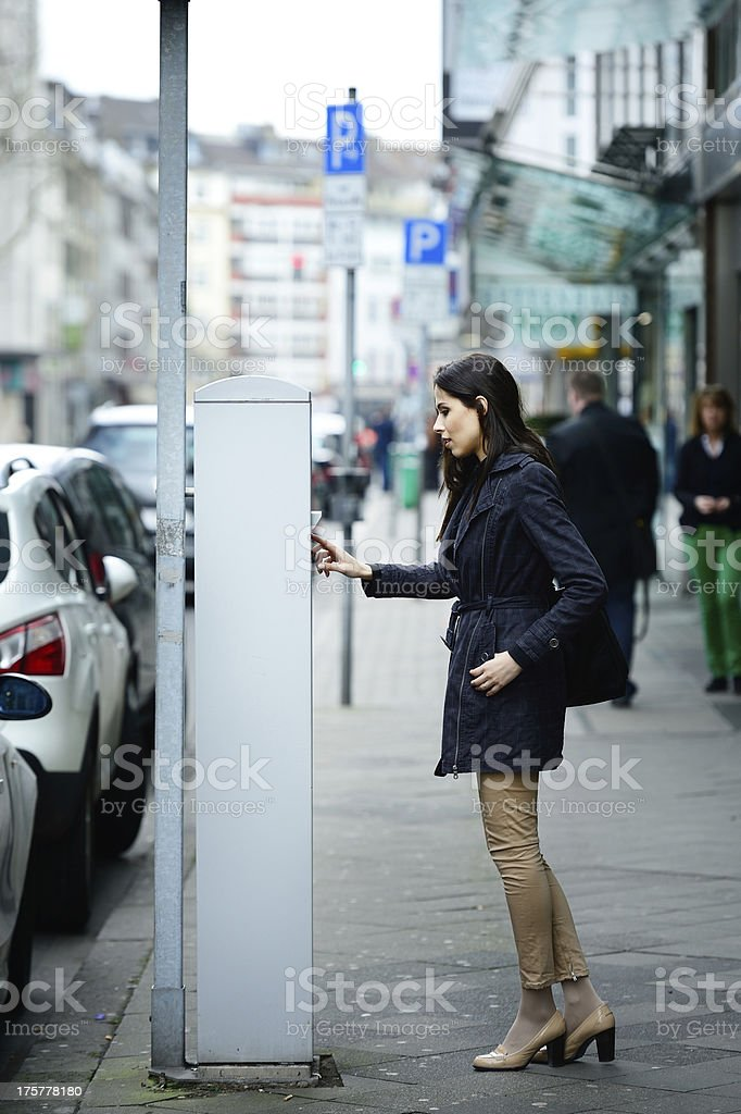 Woman and parking meter royalty-free stock photo