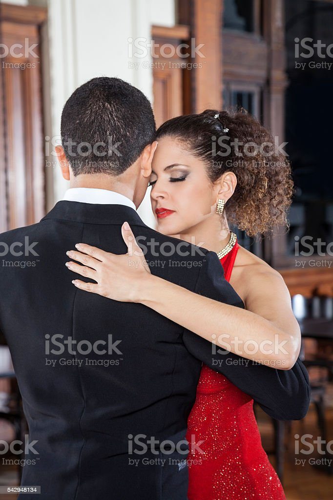 Woman And Partner Touching Foreheads While Performing Tango stock photo