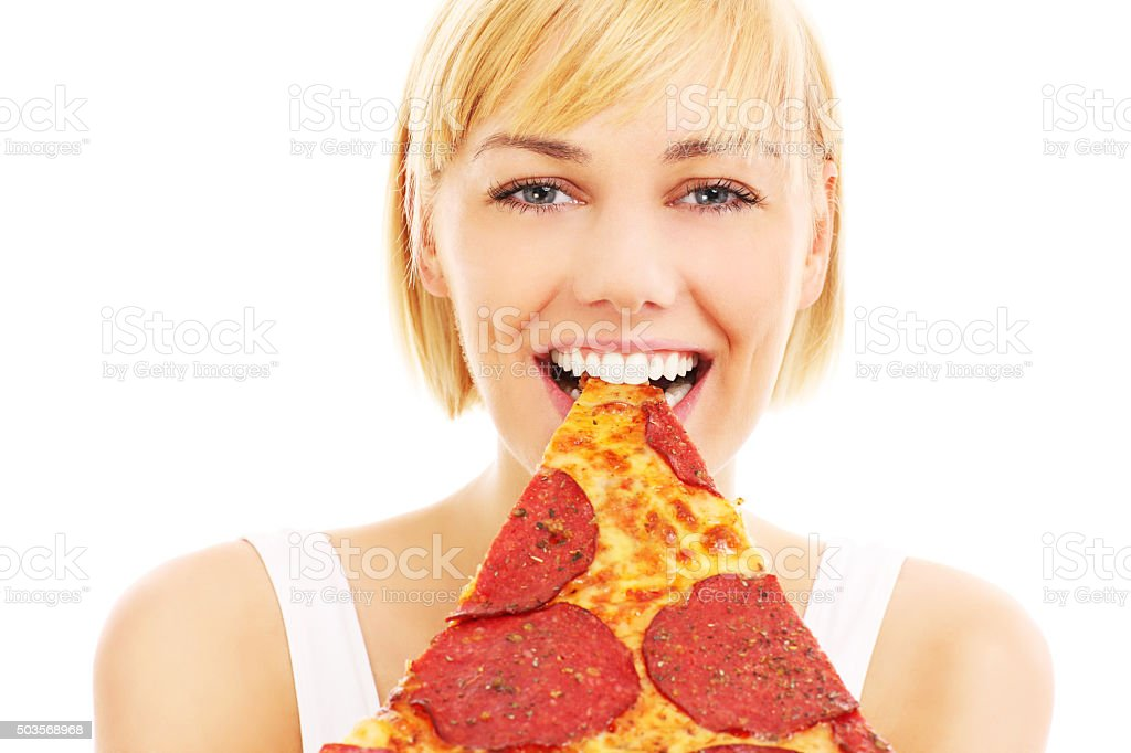 Woman and pepperoni pizza stock photo