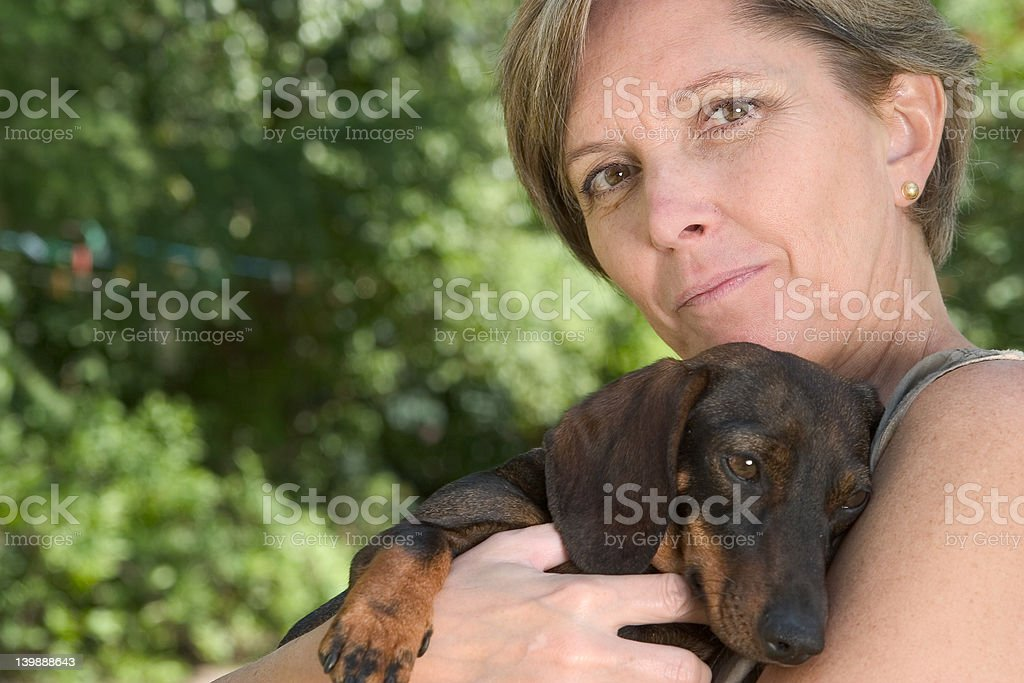 Woman and puppy royalty-free stock photo