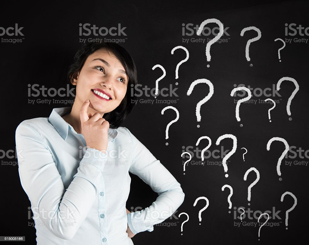 woman and question marks stock photo