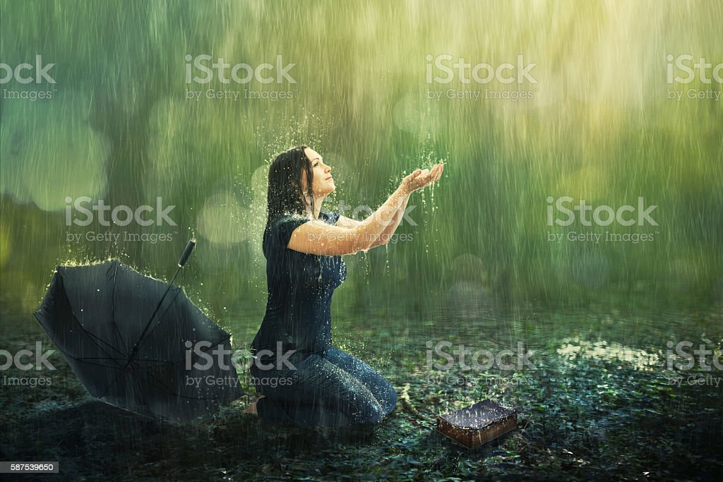 Woman and rain shower stock photo