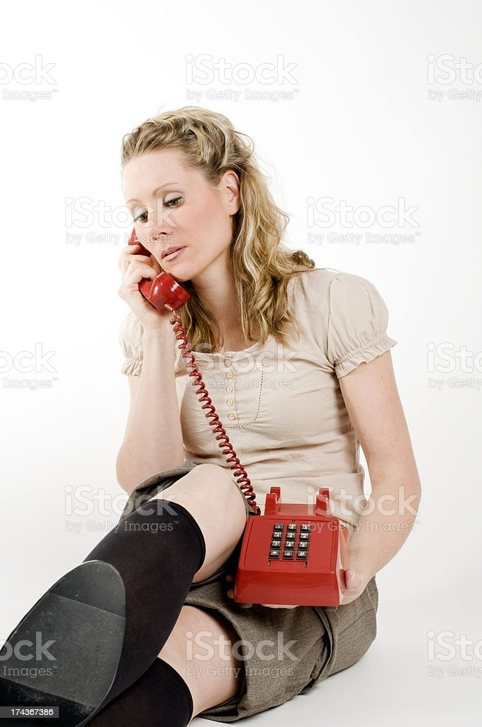 Woman and Red Vintage Telephone stock photo