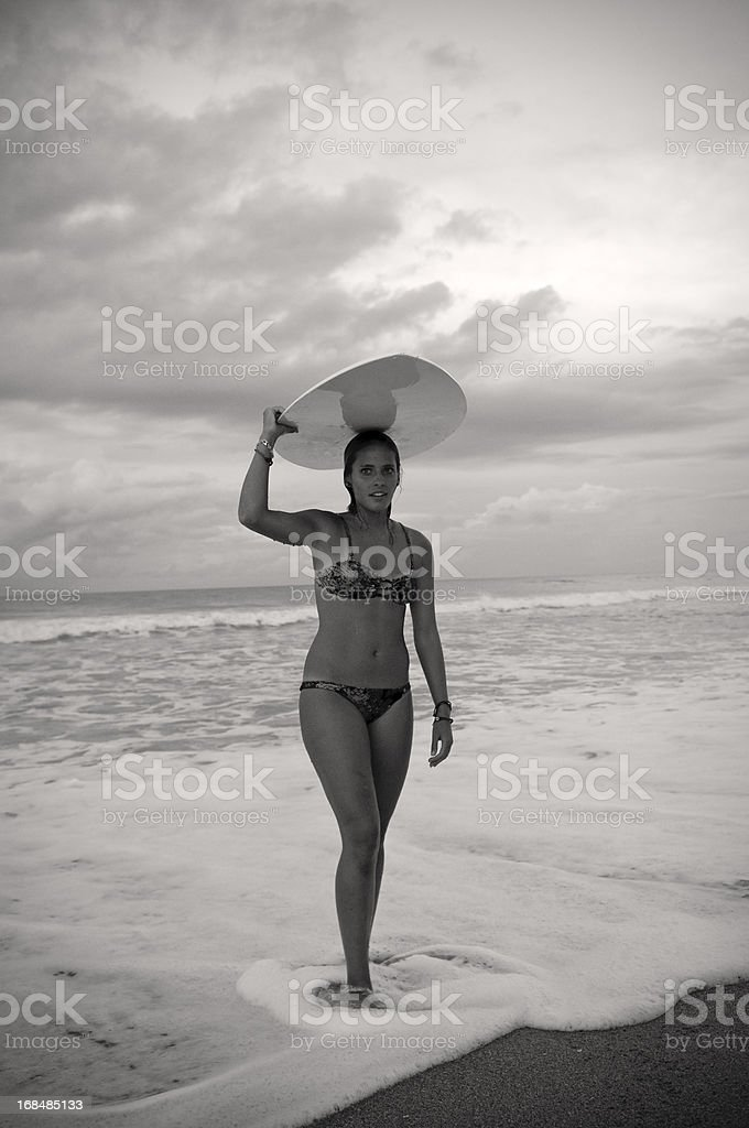 Woman and skimboard on beach in Florida stock photo
