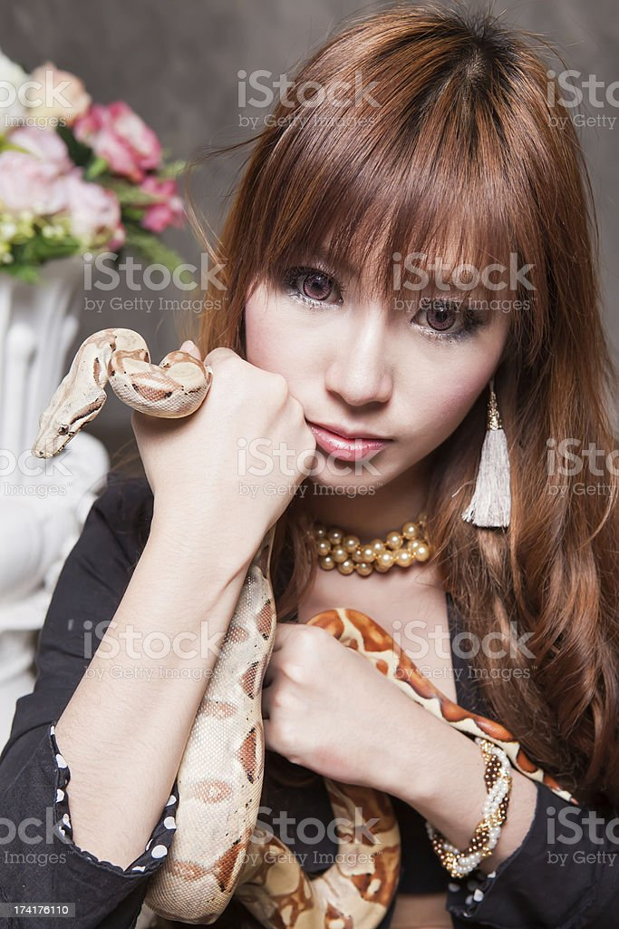 Woman and Snake portrait royalty-free stock photo