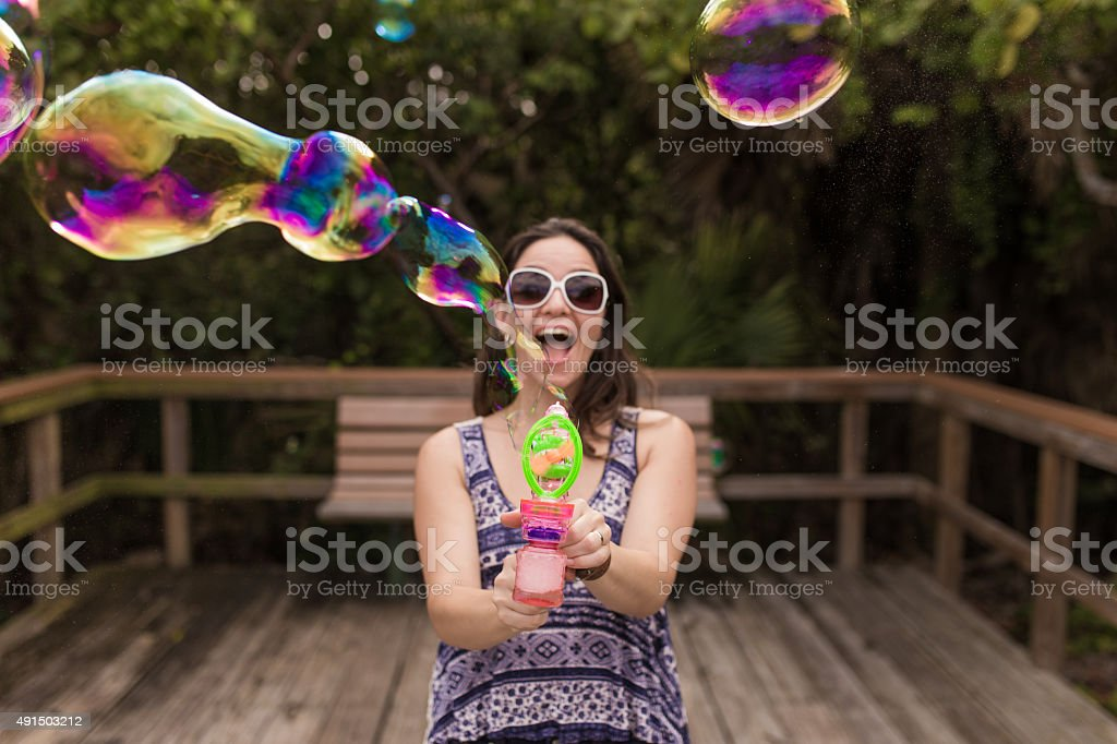 Woman and soap bubbles stock photo