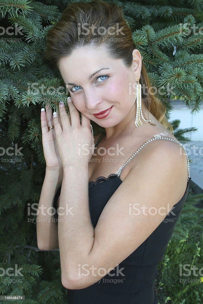 woman and spruce royalty-free stock photo
