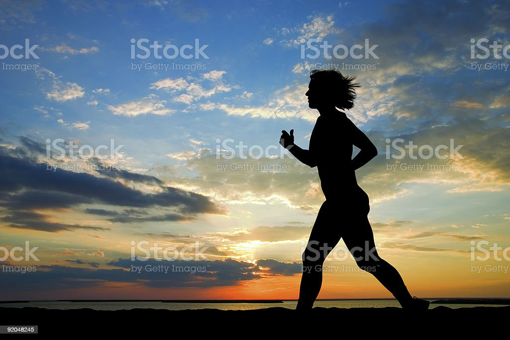 Woman and susnset stock photo