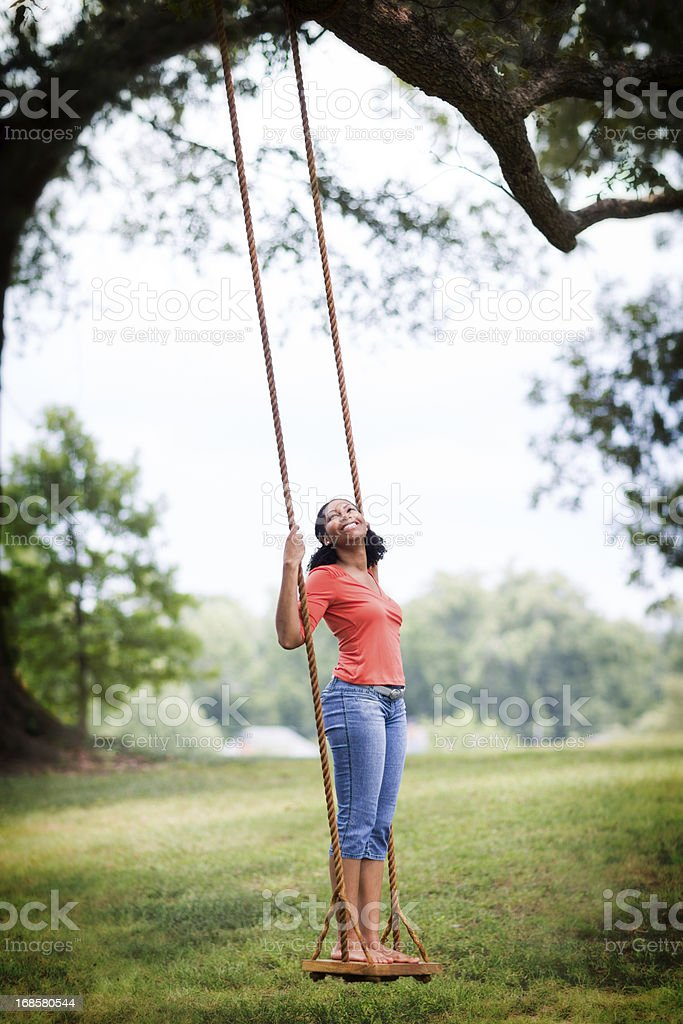 Woman and Swing stock photo