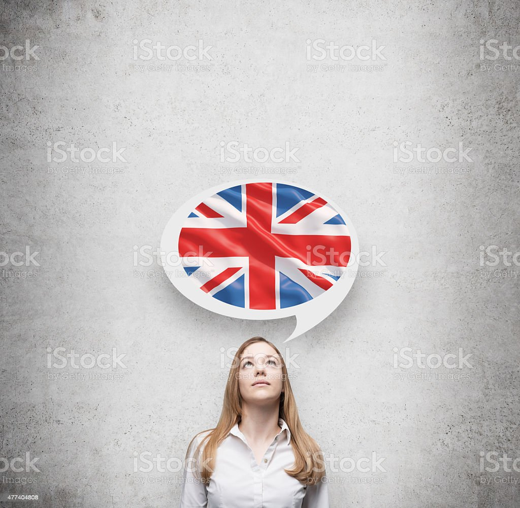woman and thought bubble above head with Great Britain flag stock photo
