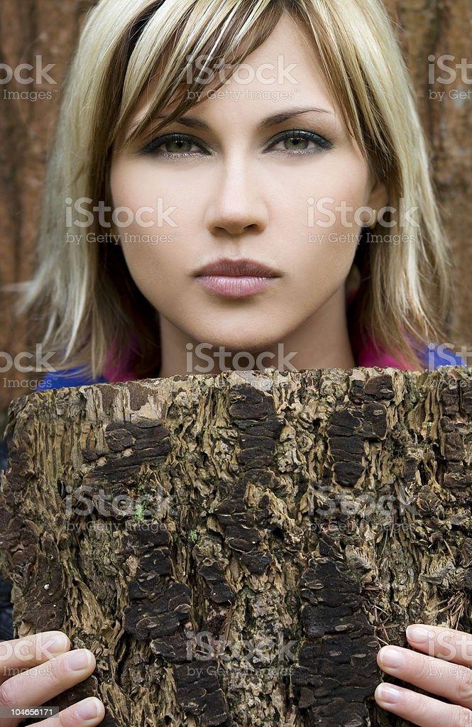 Woman and tree bark royalty-free stock photo