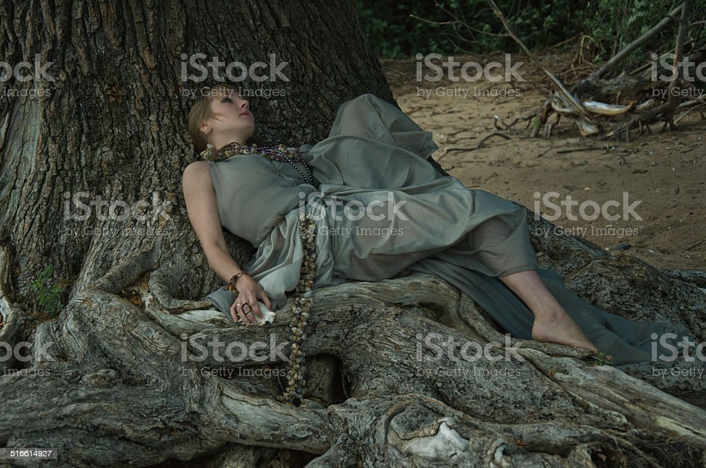 woman and tree stock photo