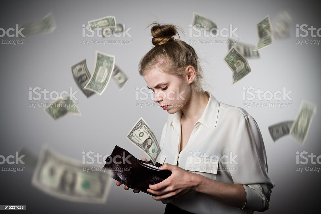 Woman and wallet. Dollars. stock photo