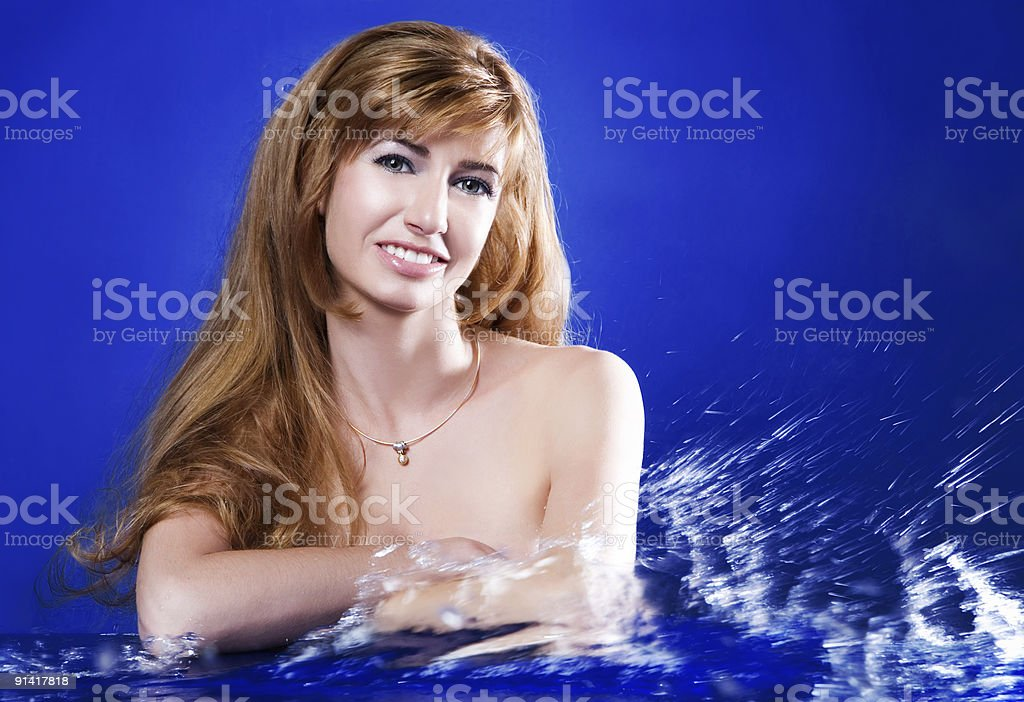 woman and water on blue background royalty-free stock photo