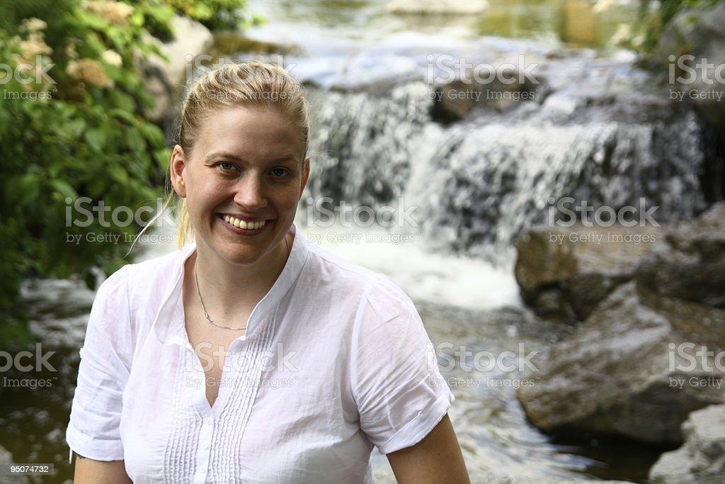 Woman and waterfall stock photo