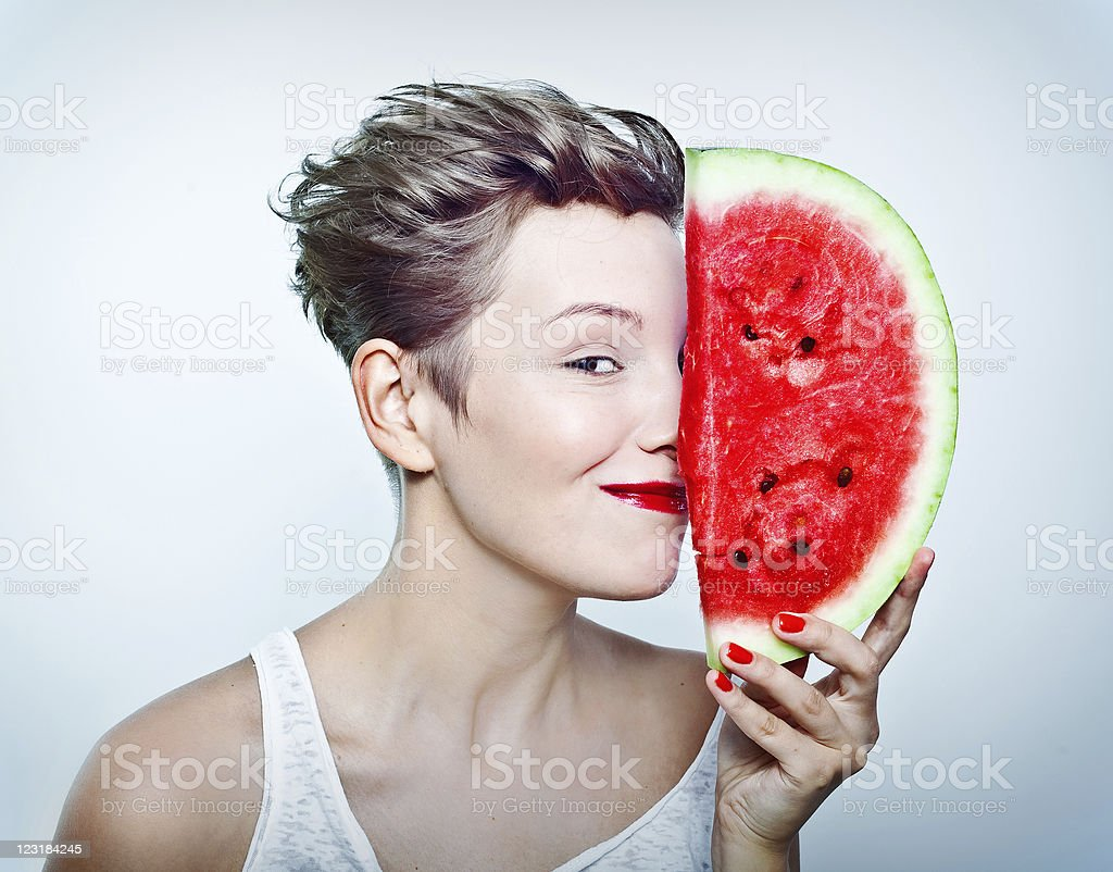 woman and watermelon royalty-free stock photo