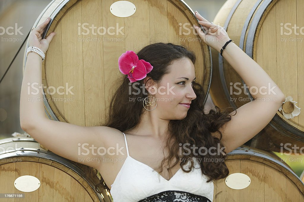woman and wine barrels royalty-free stock photo