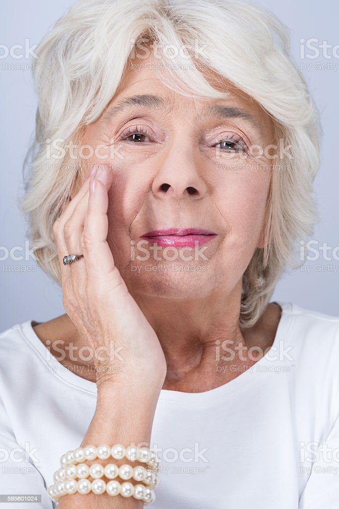 Woman and working anti-aging cream stock photo
