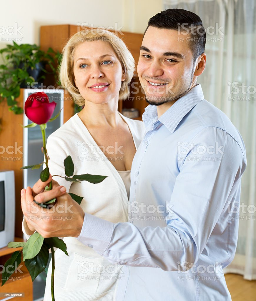 woman and young boyfriend dancing stock photo