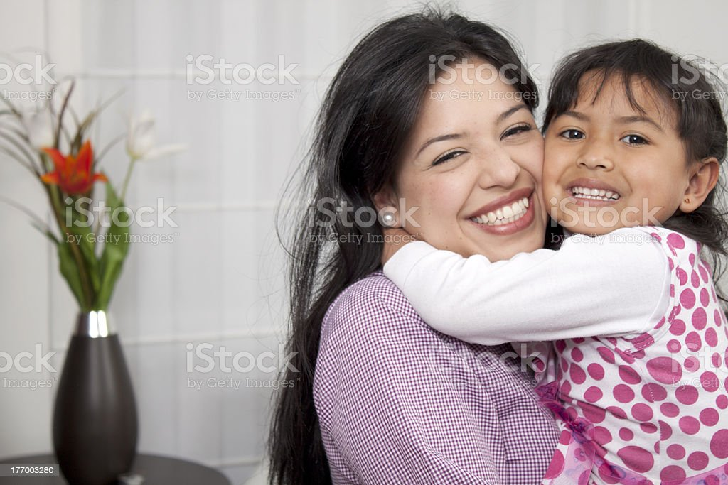 Woman and young girl in living room stock photo