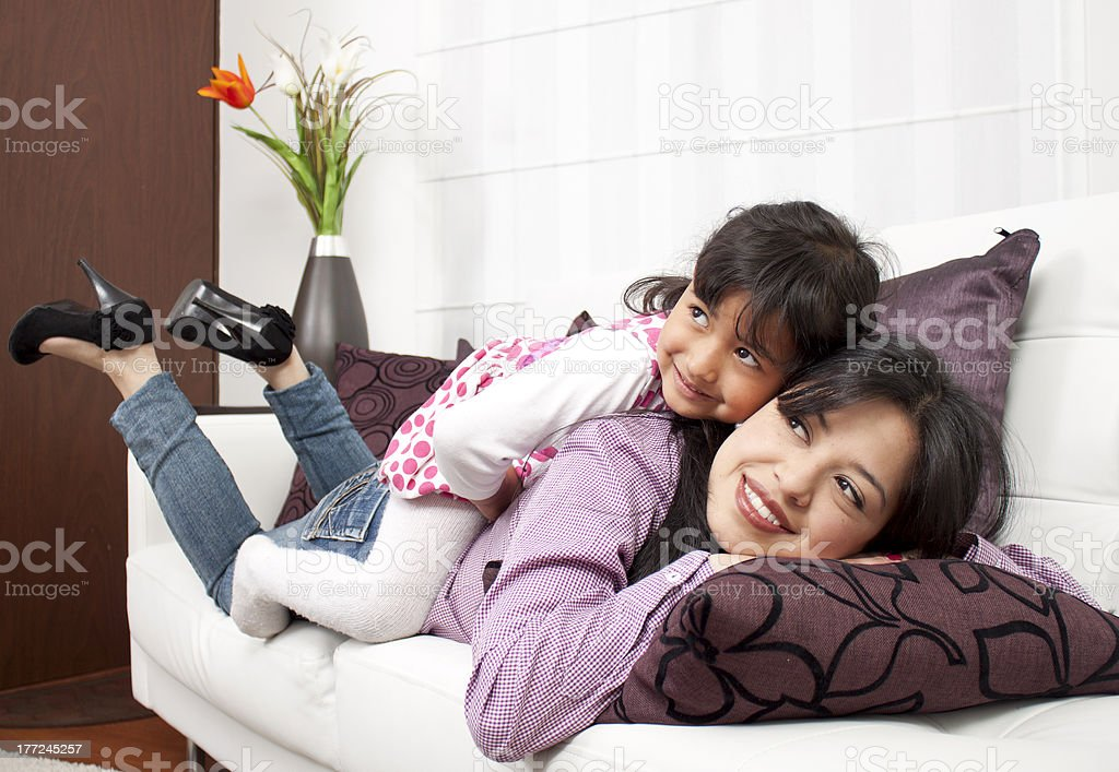 Woman and young girl lying royalty-free stock photo