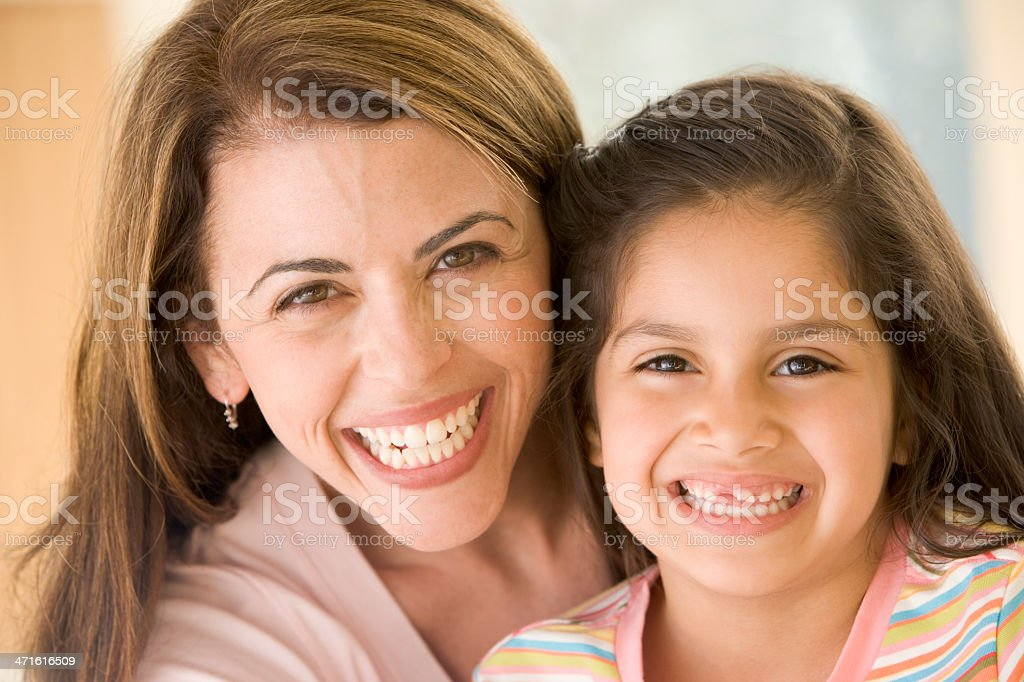 Woman and young girl smiling royalty-free stock photo