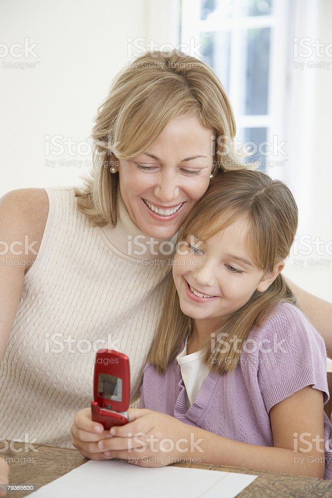 Woman and young girl with her mobile phone royalty-free stock photo
