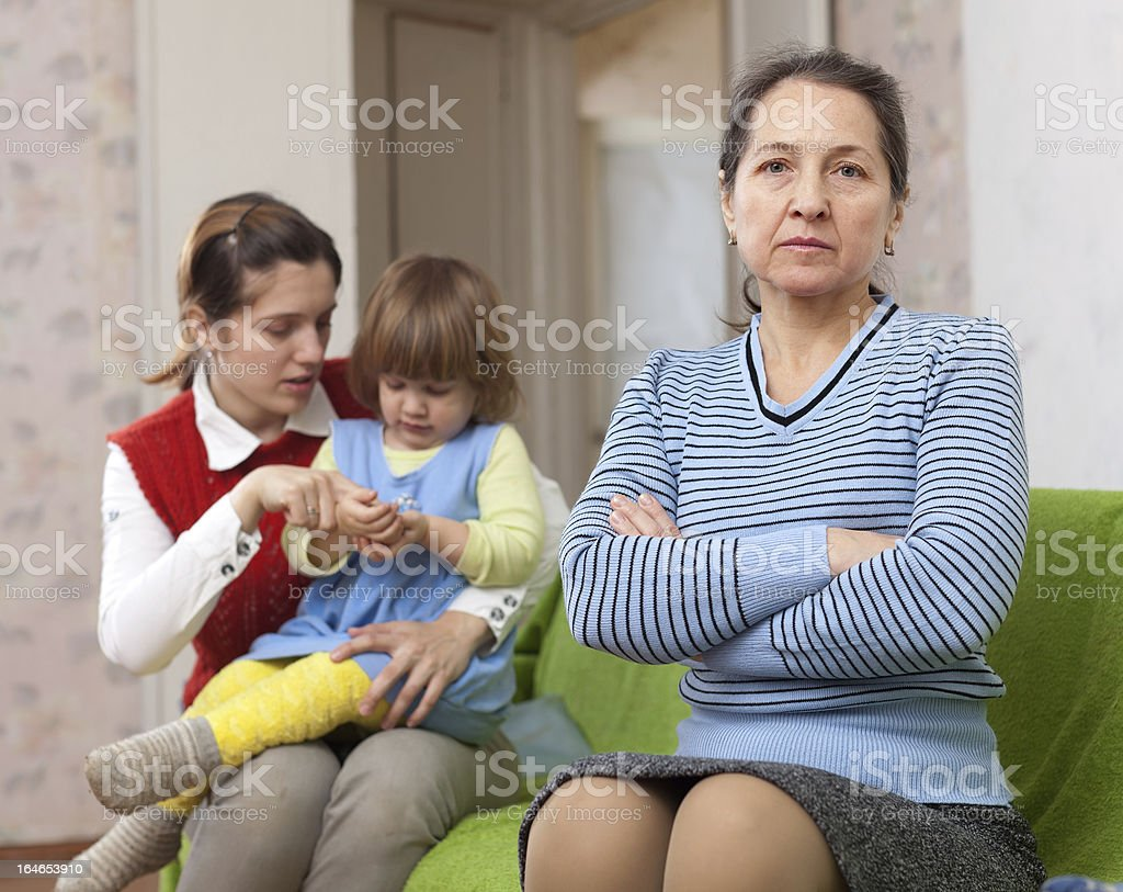 woman and young mother with baby after quarrel royalty-free stock photo