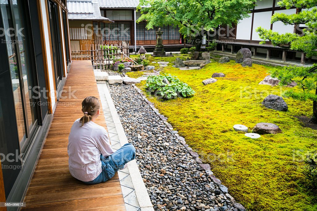 Woman and Zen garden  of Chion-ji temple in Kyoto, Japan stock photo