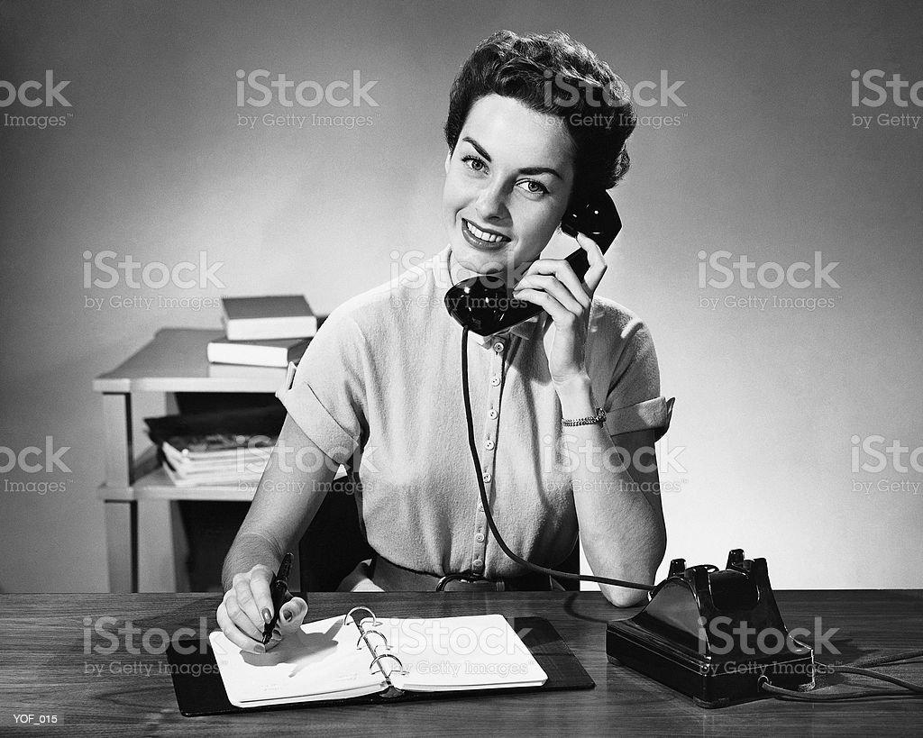 Woman answering phone stock photo