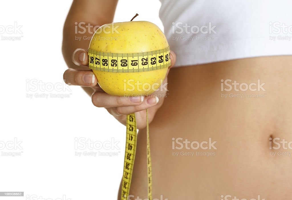 Woman, apple and measuring tape isolated on white royalty-free stock photo