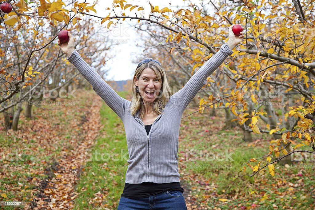 Woman & Apple trees royalty-free stock photo