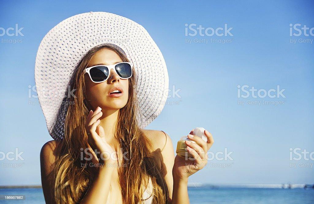 Woman apply sunscreen stock photo