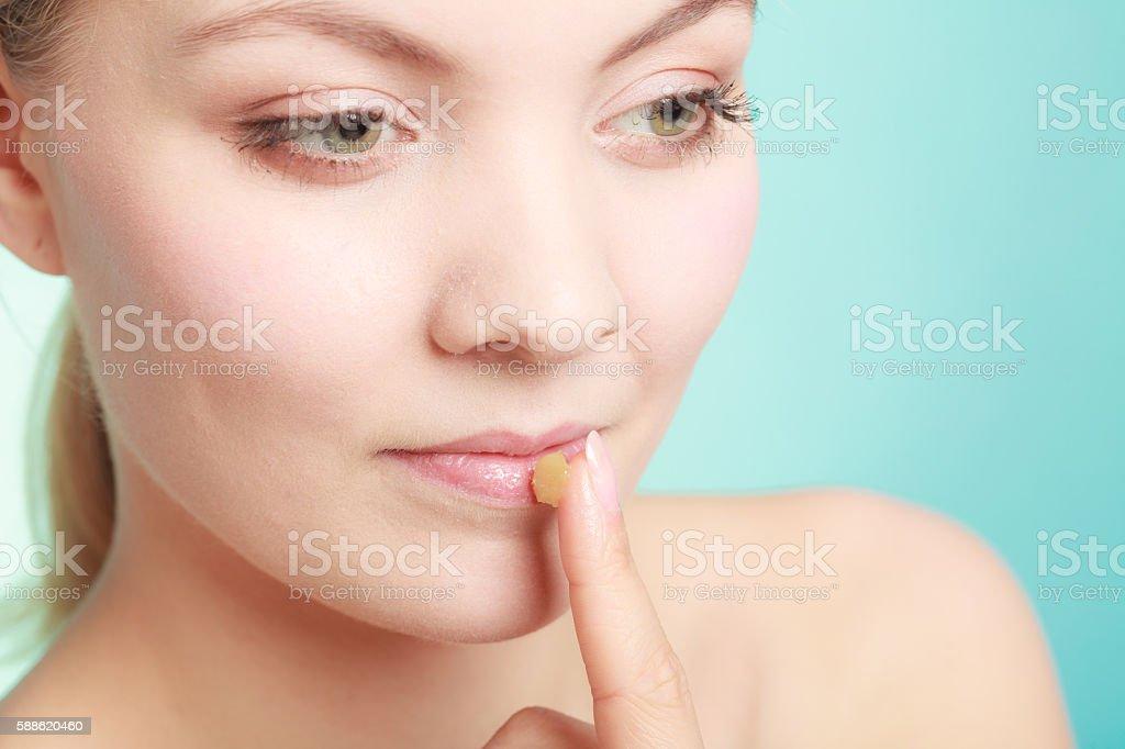 woman applying balsam for lips stock photo