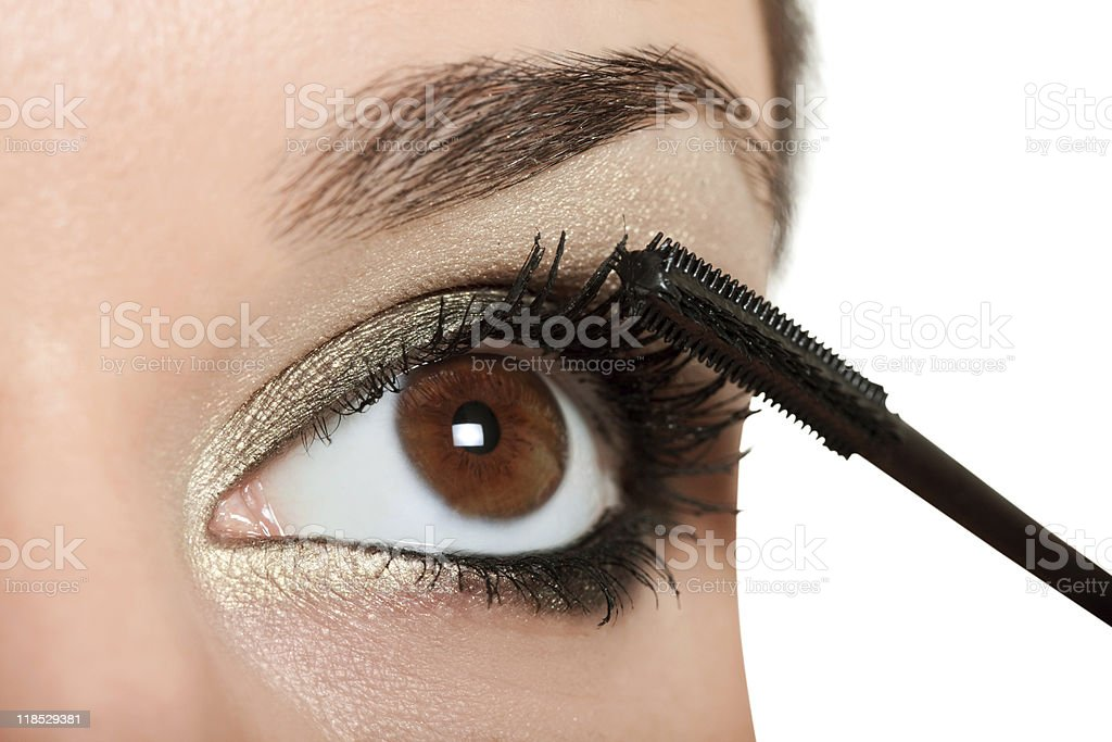 woman applying  black masara stock photo