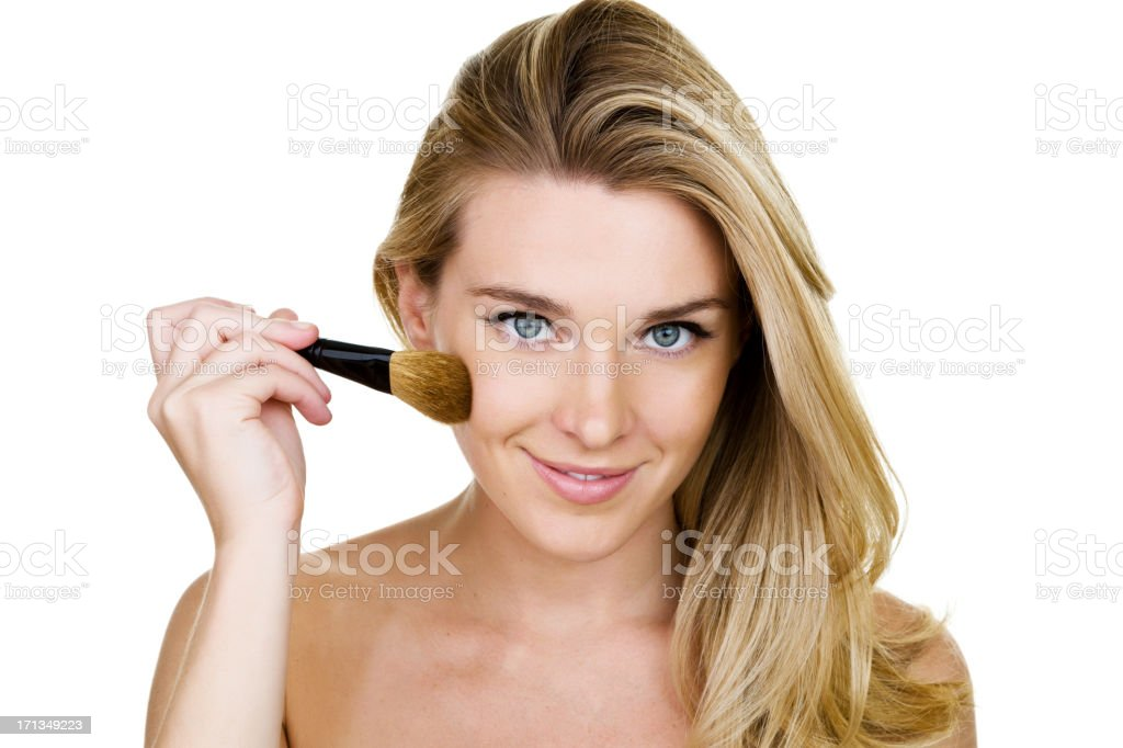 Woman applying blush royalty-free stock photo