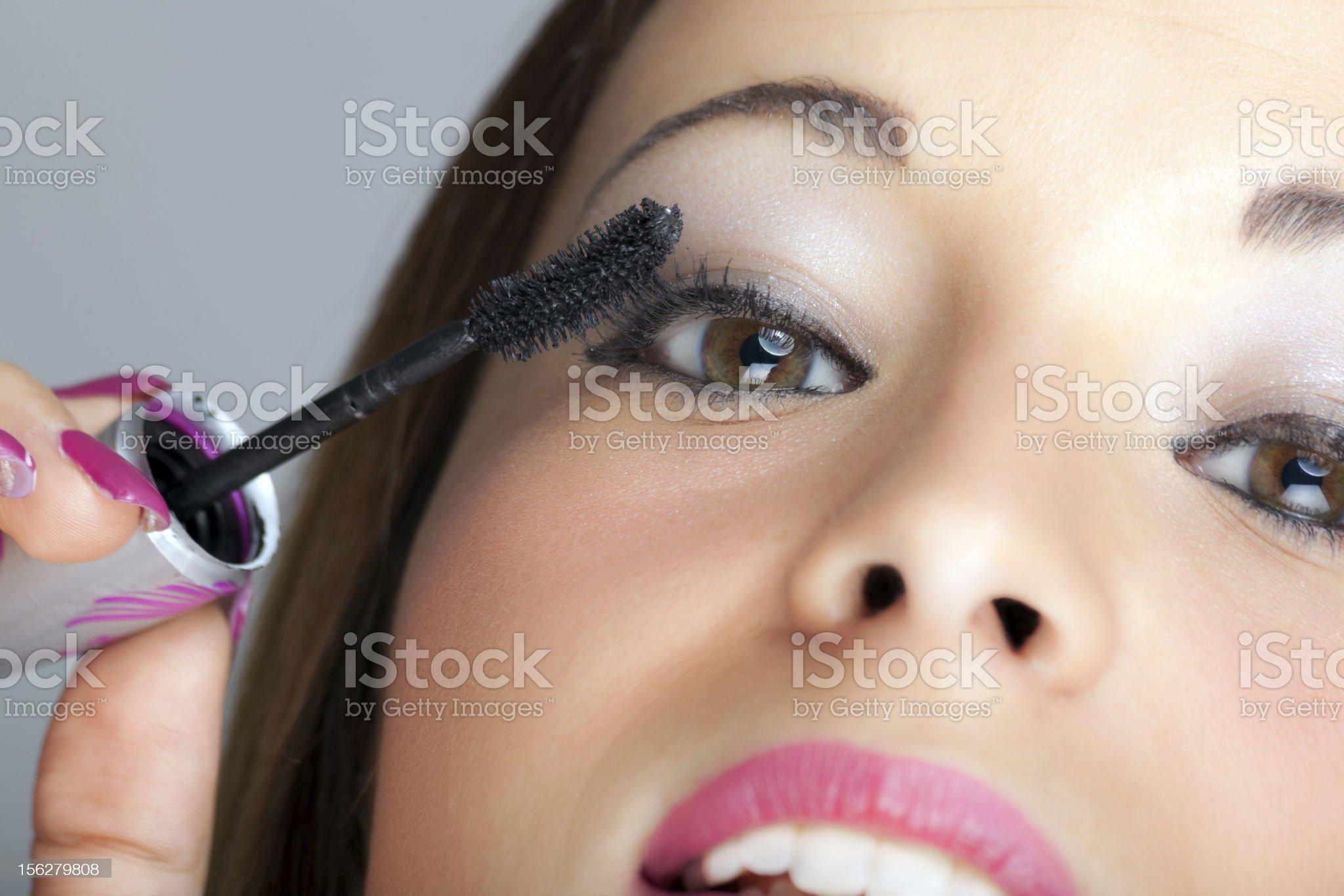 Woman applying blusher royalty-free stock photo