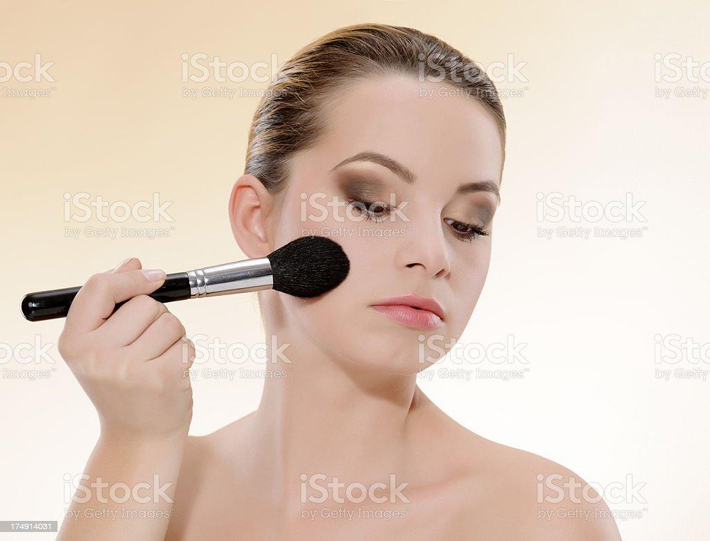 woman applying brush royalty-free stock photo