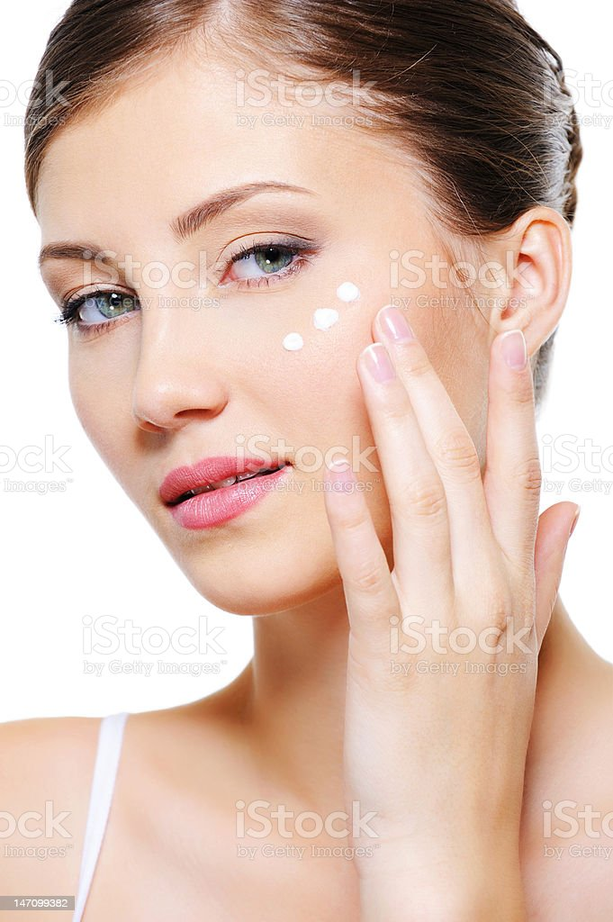 Woman applying cosmetic cream royalty-free stock photo