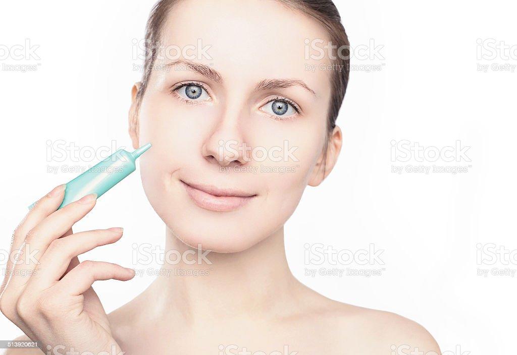 Woman applying cream, beauty, health skin - concept stock photo