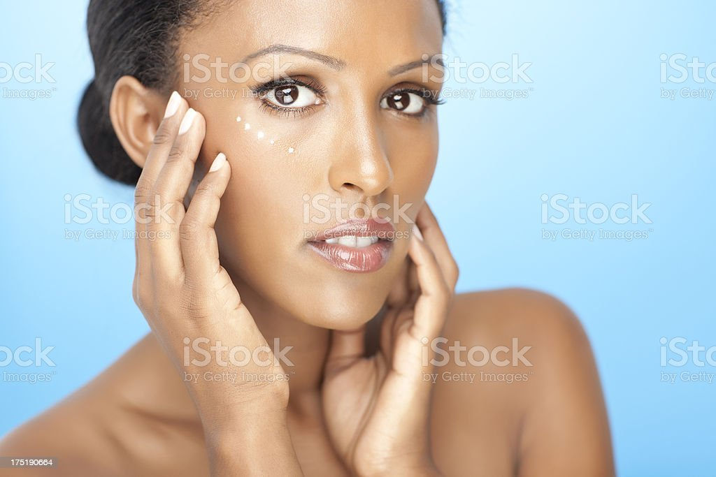 Woman applying eye cream. royalty-free stock photo