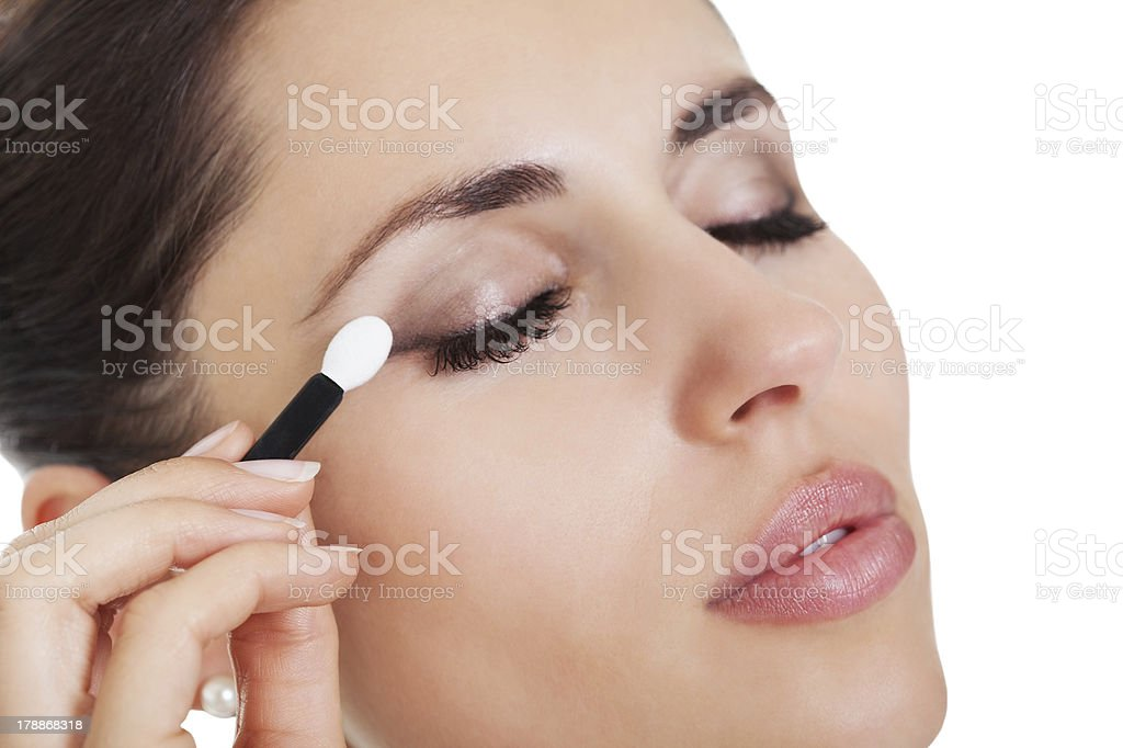 Woman applying eye shadow royalty-free stock photo