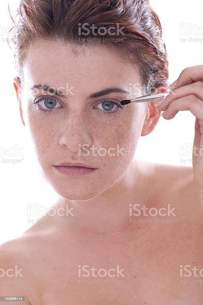 woman applying eyeshadow stock photo