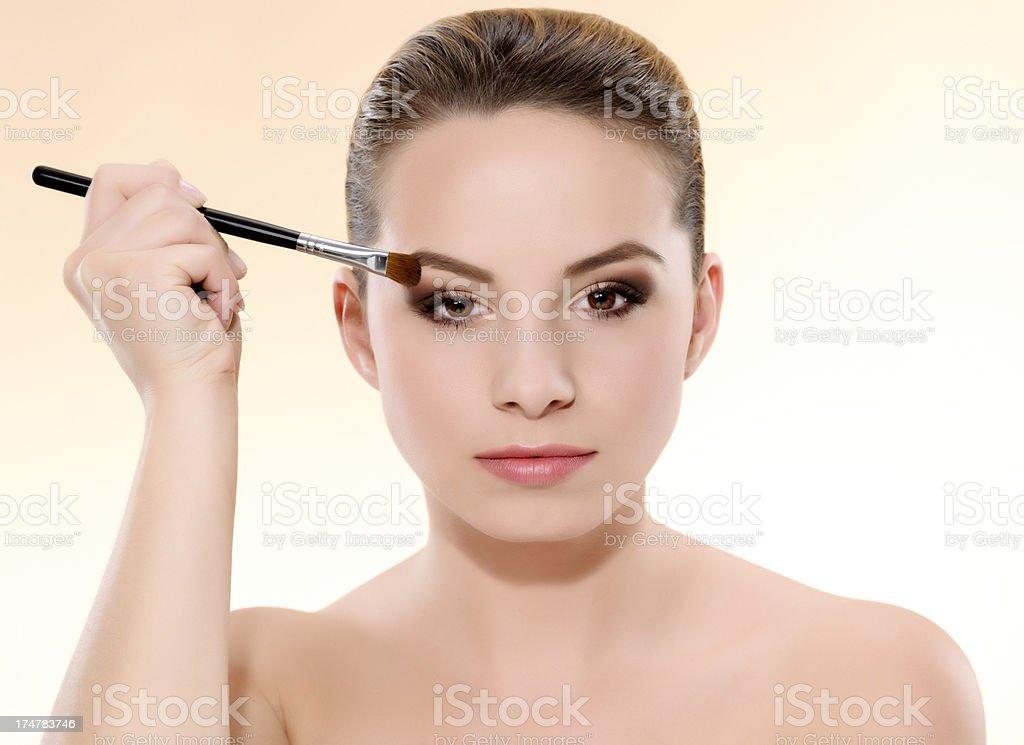 woman applying eyeshadow royalty-free stock photo