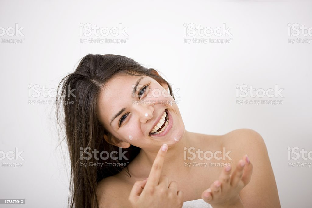Woman applying face cream royalty-free stock photo